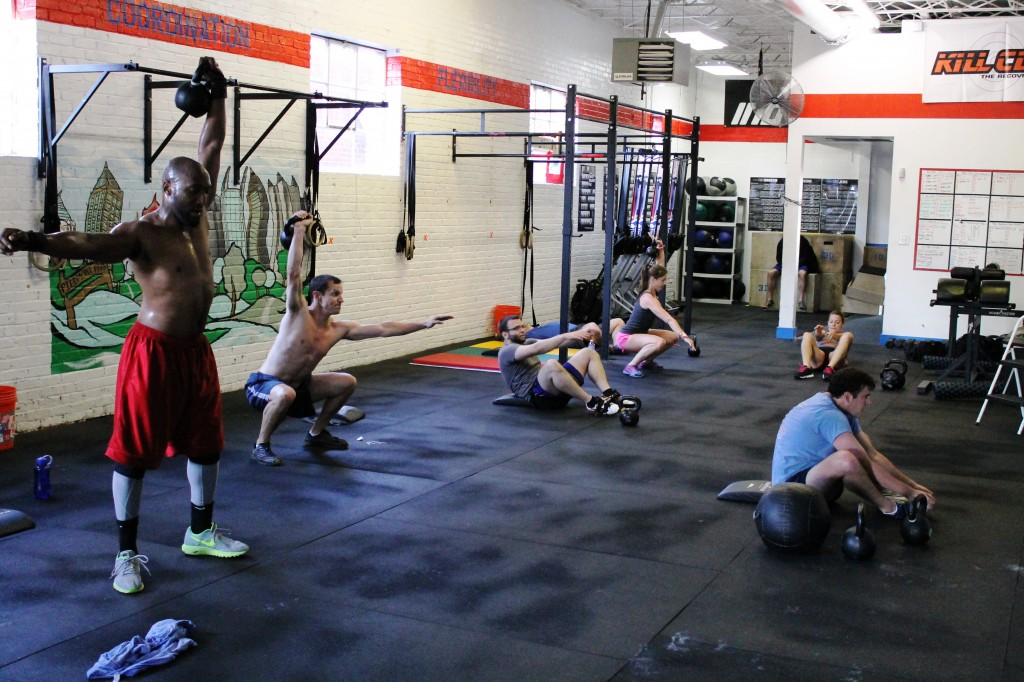 1-arm kettlebell overhead squats at 6pm class