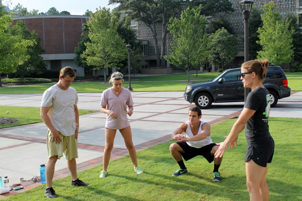 Partner WOD on Tech Campus. Coach Kelly leading the warmup.