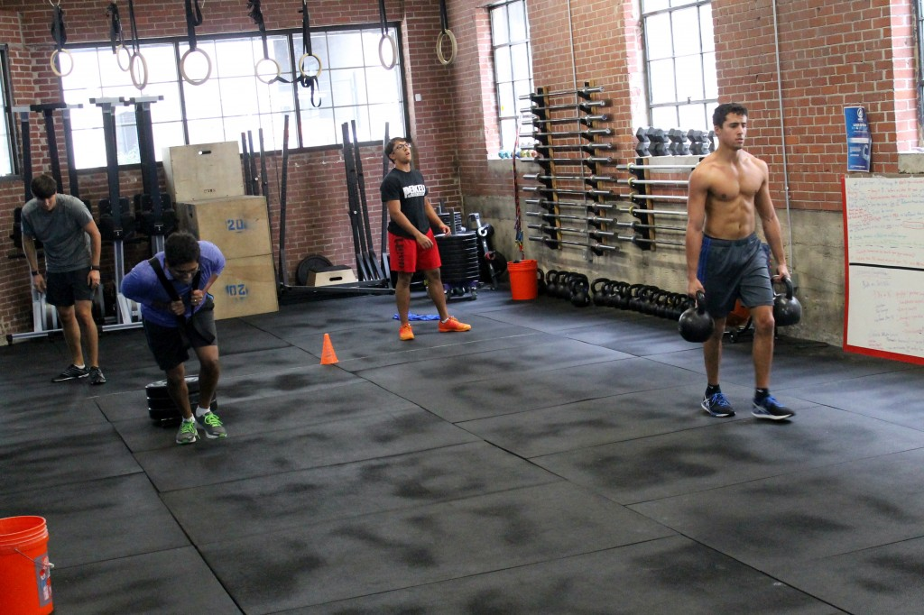 Team yard work: Sled pull and farmer's carry