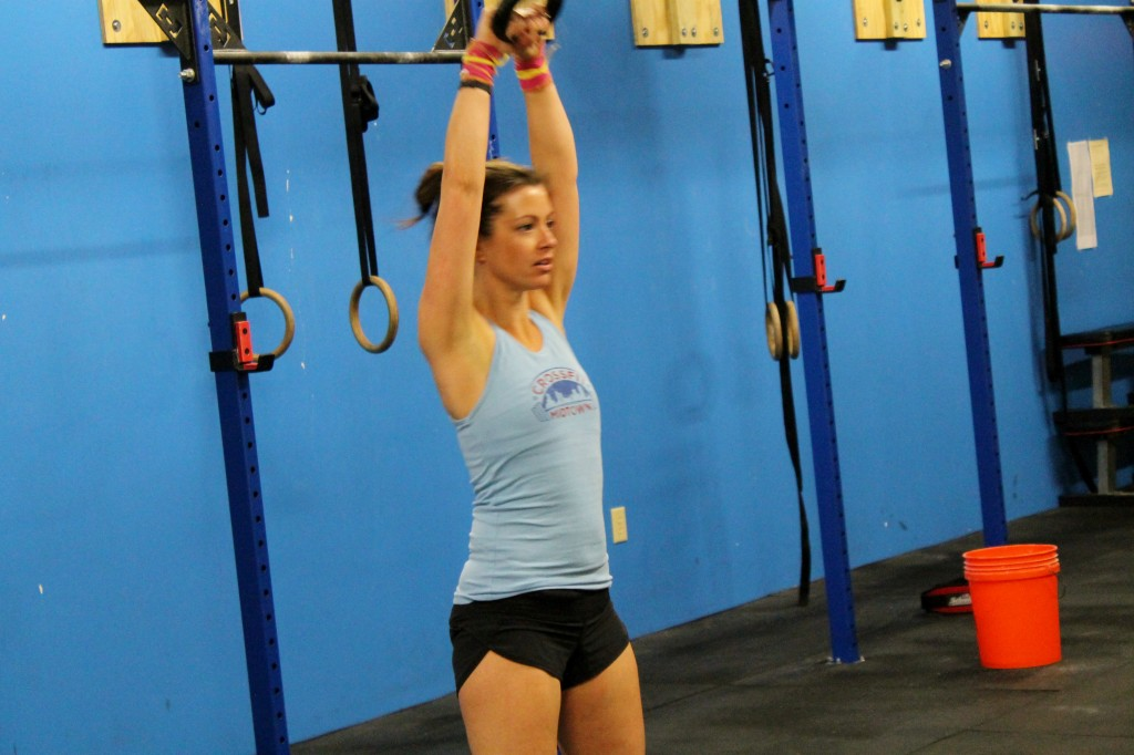 Tiffany at the top of a kettlebell swing