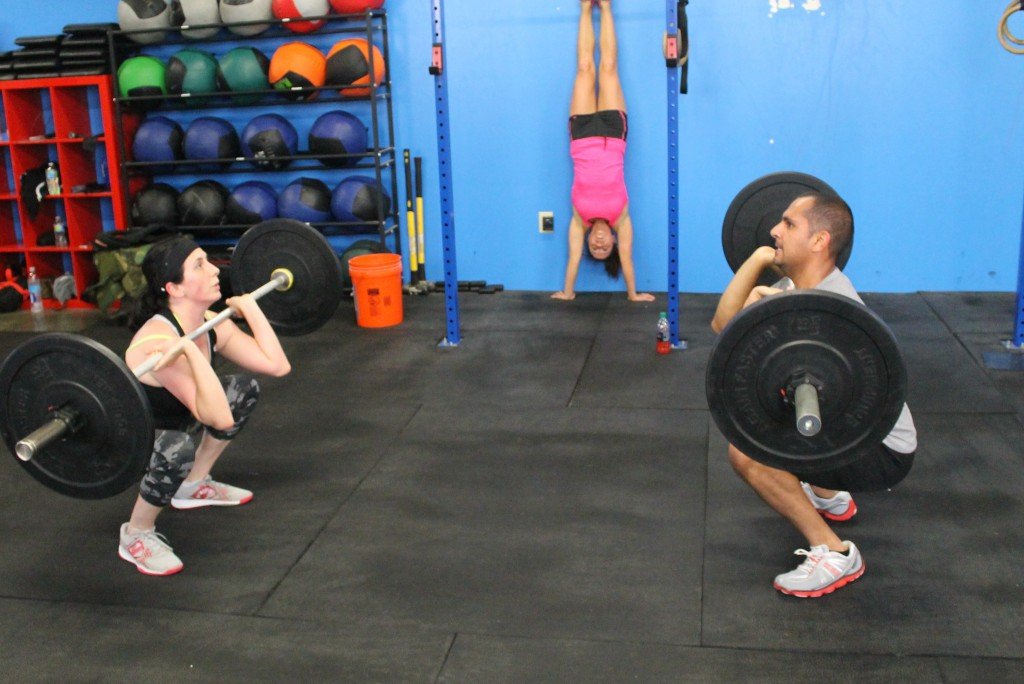 Front squats and partner handstand holds