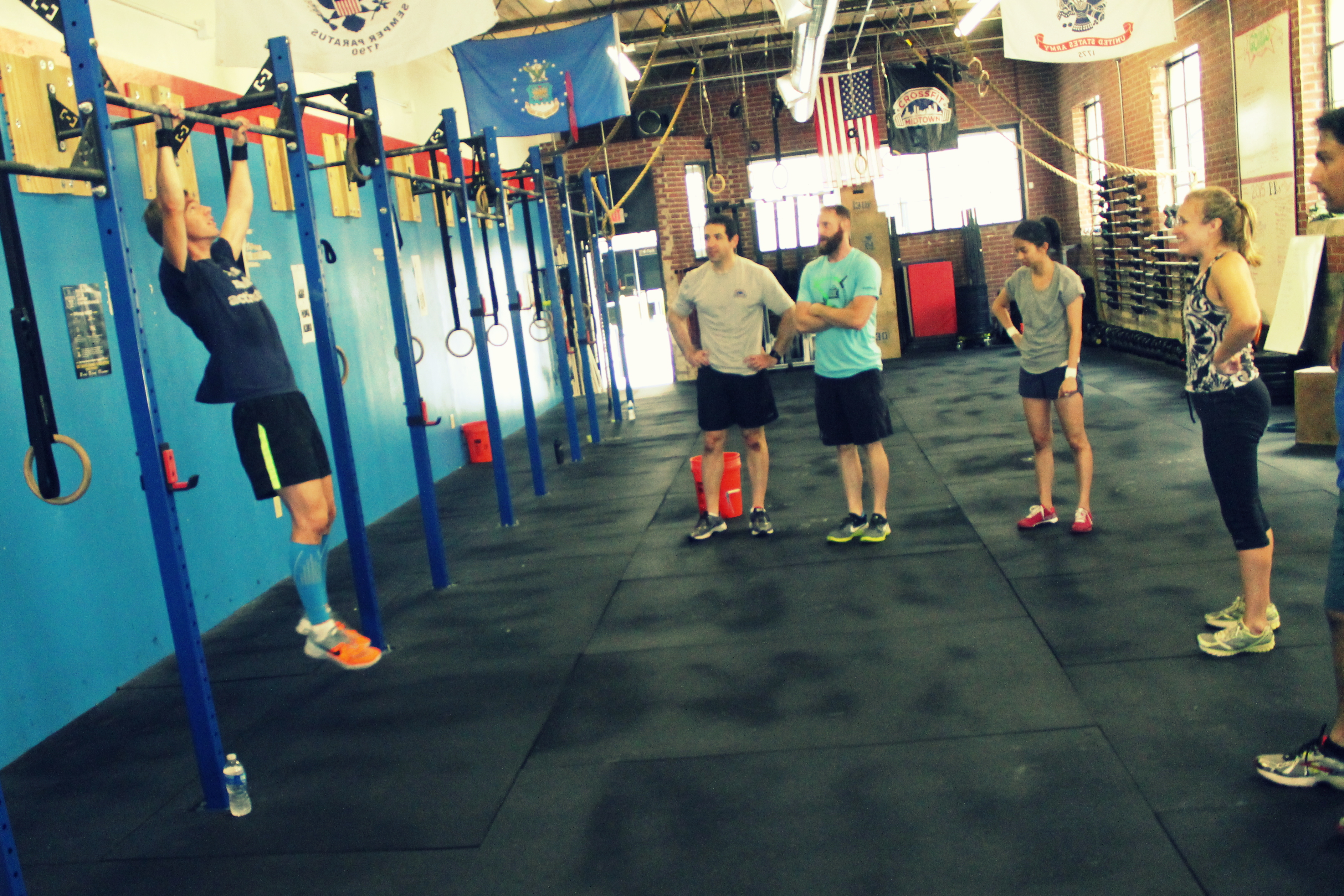 Lana Wilson Crossfit Midtown Pics Photos Circuit Training Workout 11 28 11a Cary Demoing Kipping Pullups For The Class