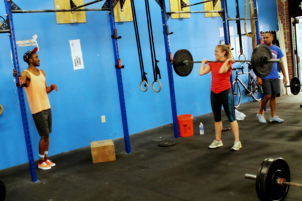 Coach Richard giving a cue to Anne-Marie on the power clean