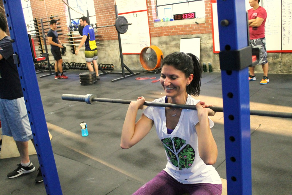 She's having fun learning the front squat.