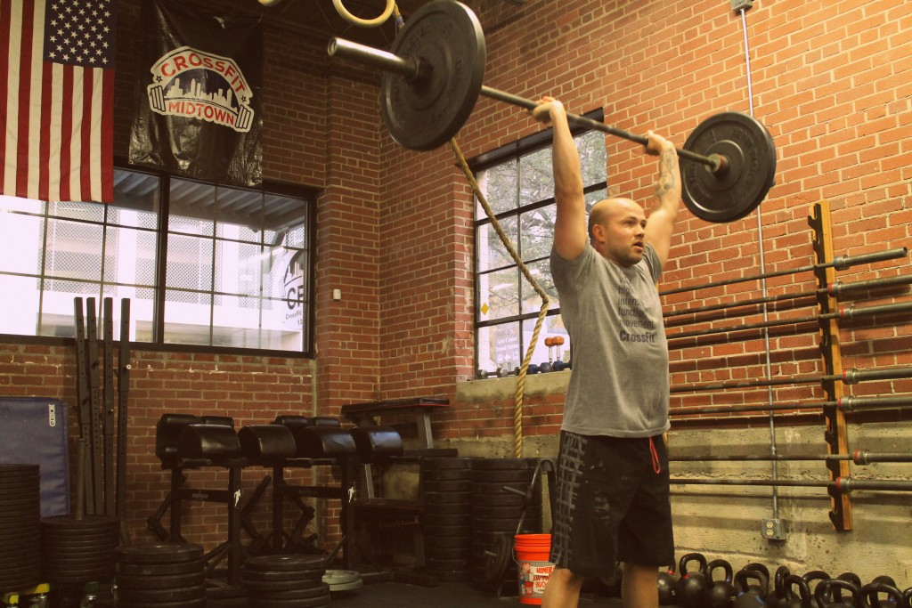 Coach Travis knocking down some thrusters