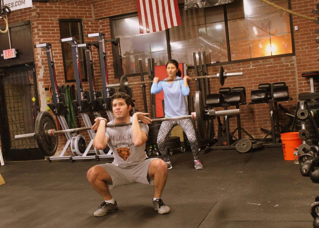 Rodrigo and Dobrinka keeping their elbows up on front squats