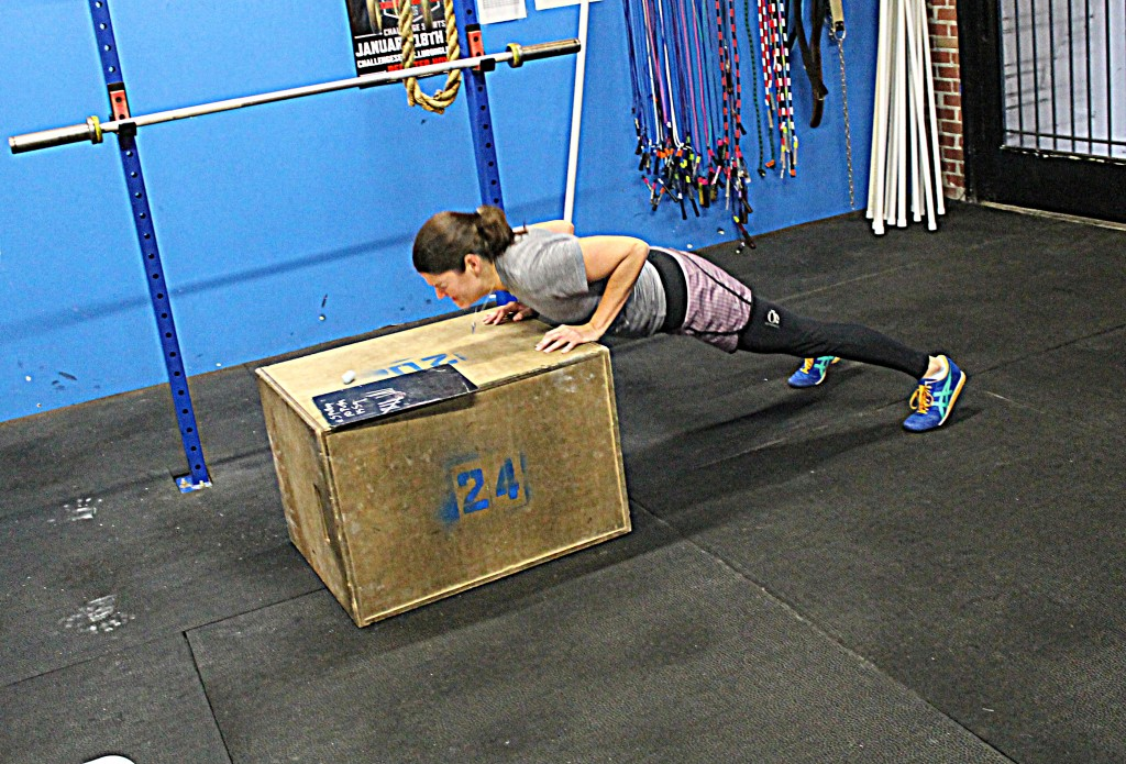 Darcy keeping a plank during incline pushups