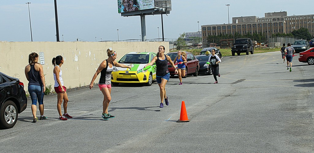 """Ellen taking the team relay hand off from Jeannette from """"Baton Relay"""" WOD"""
